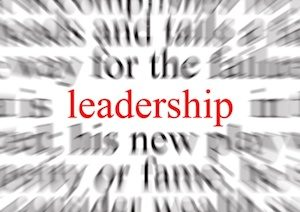 Blurred text with a focus on leadership